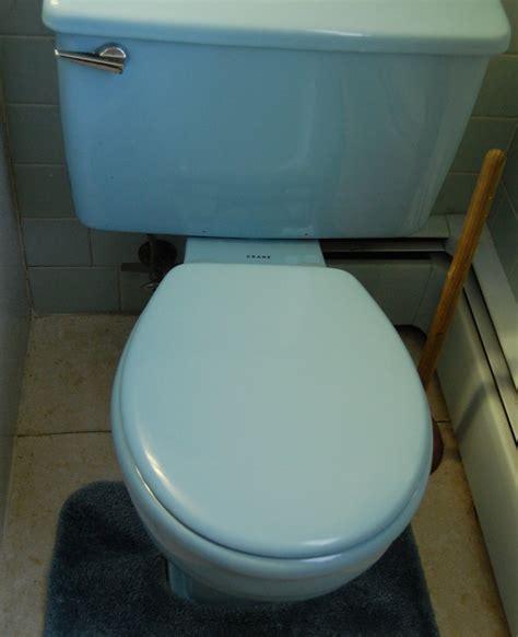 a 1964 blue bathroom with built in mack nutone