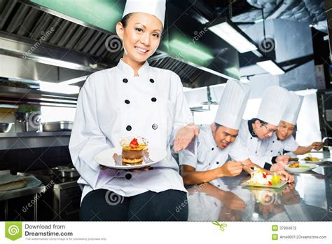 Chinese Chef In Restaurant Kitchen Stock Photography