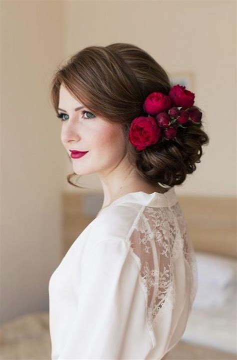 red flower hairpiece  updo wedding hairstyle