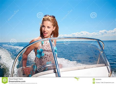 Driving Boat In Dream by Summer Vacation Girl Driving A Motor Boat Stock Photo