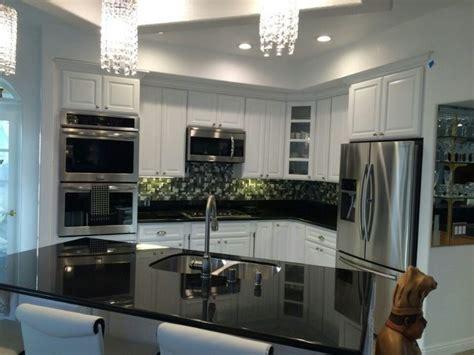 white cabinets black granite what color backsplash black galaxy granite white cabinets roselawnlutheran