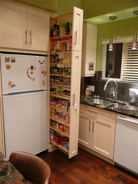 freestanding island for kitchen the narrow cabinet beside the fridge pulls out to reveal a