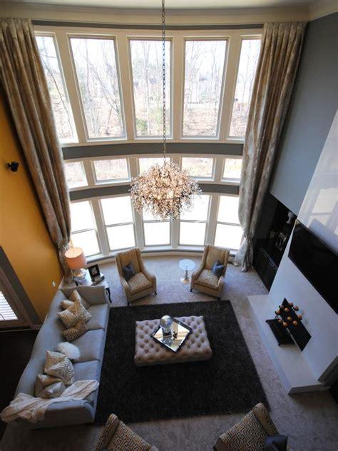 transitional gray living room   story windows hgtv