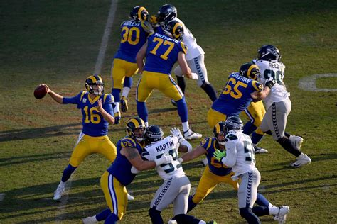 los angeles rams give qb jared goff  year  million