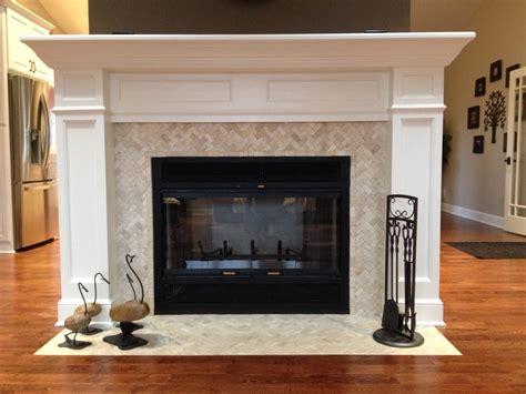 herringbone mosaic fireplace surround and