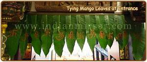 TYING OF MANGO LEAVES AT THE ENTRANCE OF THE HOUSE