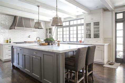 gray kitchen island  gray linen tufted counter stools