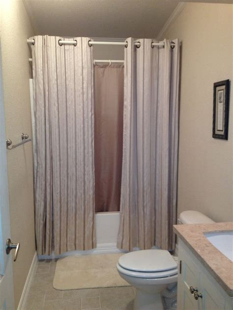 hanging shower curtains   small bathroom  bigger