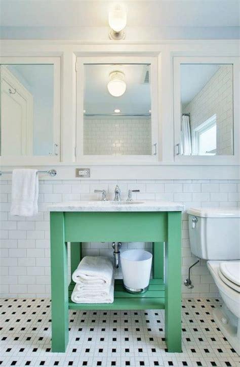 white  green bathroom  row  white framed medicine