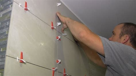 how to install large format tiles on bathroom walls using level master