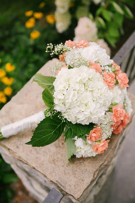 white hydrangea  peach carnation bridal bouquet