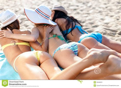 Girls Sunbathing On The Beach Stock Image Image Of