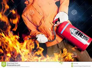 Fireman Fighting A Raging Fire With Big Flames Royalty ...