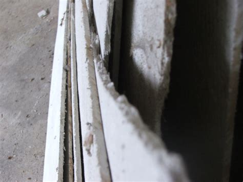 Insulating Ceiling Panels by Asbestos Insulation Board