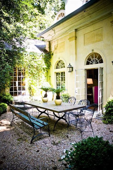 gravel courtyard pea gravel courtyard courtyard pinterest table and chairs wanderlust and style