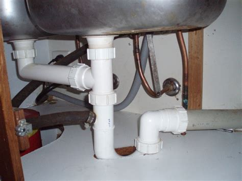 leaking pipe under sink how to fix and clean a leak in a u bend under the sink