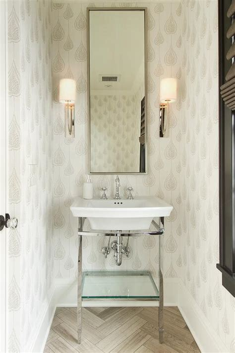small white and tan powder room with herringbone tile floor transitional bathroom