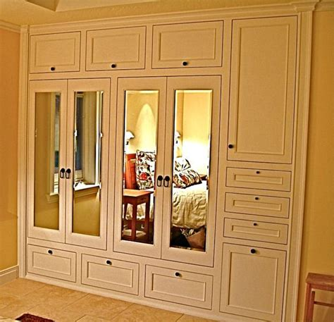 adore this handmade custom built in his hers closets