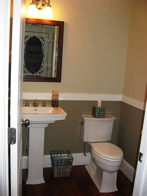pedestal sink dark floors chair rail  bath ideas