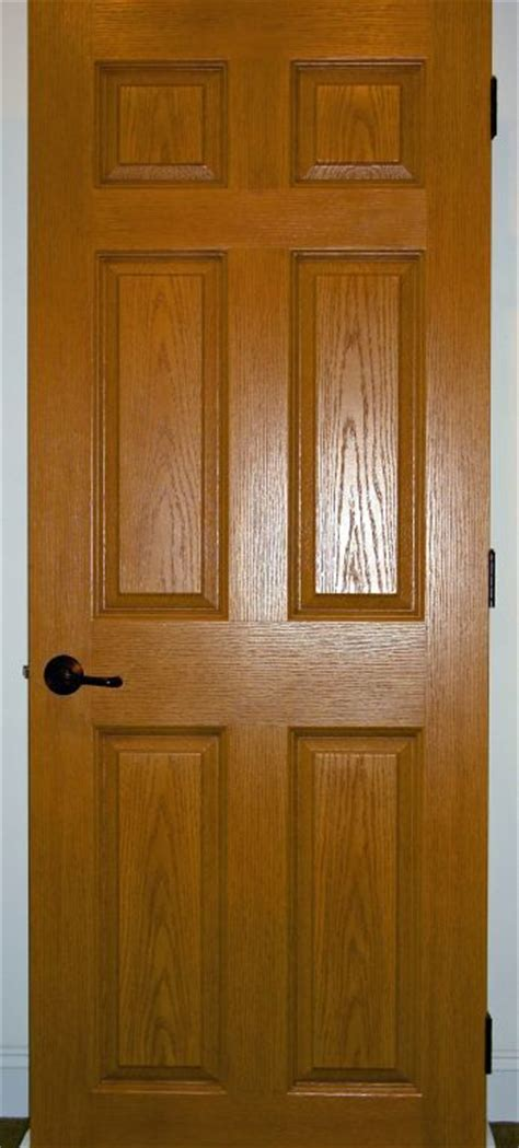 oak stained solid core  panel interior door modular homes  manorwood homes  affiliate