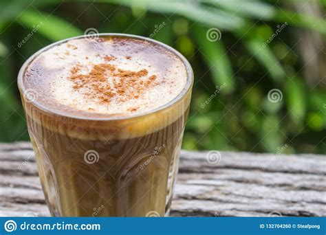 Heze big tree biological engineering science and technology co., ltd. Latte Coffee In Glass On Wood Table With Natural Tree Background Stock Photo - Image of drink ...