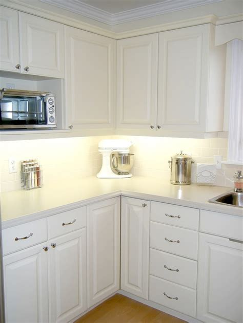 how to repaint kitchen cabinets white repainted cabinets oak to white for the home 8874
