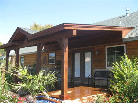 Budget Kitchen Ideas - roofed backyard patio cover with sunburst hundt patio covers and decks