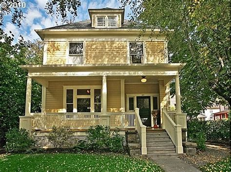 yellow clapboard house  cream trim architecture