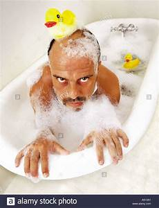 Deranged Man Hangs On The Edge Of An Old Tub In Bubble