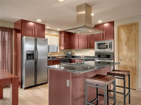 layout cherry wood cabinets and an island pair nicely