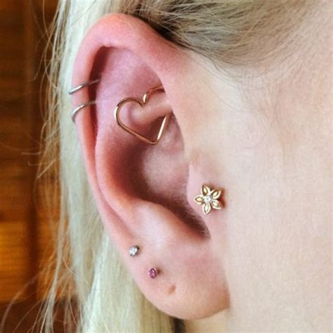 l a 39 s 10 coolest ear piercing combinations the man