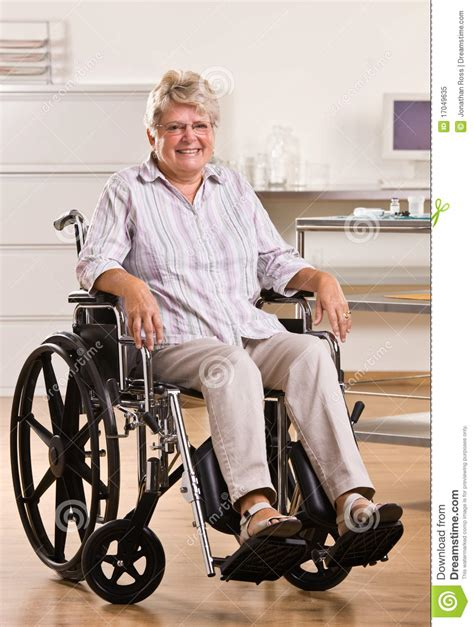 senior woman sitting  wheelchair royalty  stock