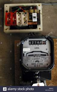 Electric Meter And A Old Style Wire Fuse Box Stock Photo  24171335