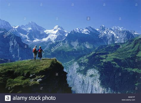 Direction Signs Alpine Hikes Alps Switzerland Stock Photo Elderly Hiking In Swiss Alps Above Lauterbrunnen