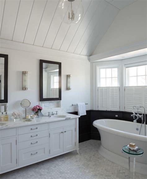 white vanity  black mirror transitional bathroom