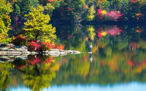 man fishing   lake fall season reflections