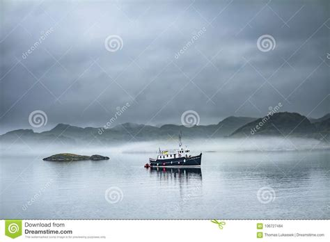 Driving Boat In Dream by Alone Boat Driving Through In The Foggy Sea In The