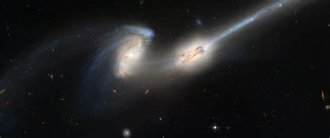 Las galaxias espirales pueden recordarte un molinillo. Download wallpaper 2560x1080 galaxy, spirals, stars, space ...