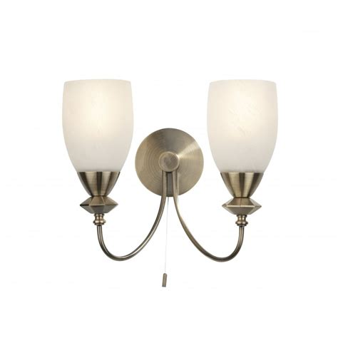 low energy wall light in antique brass with switch