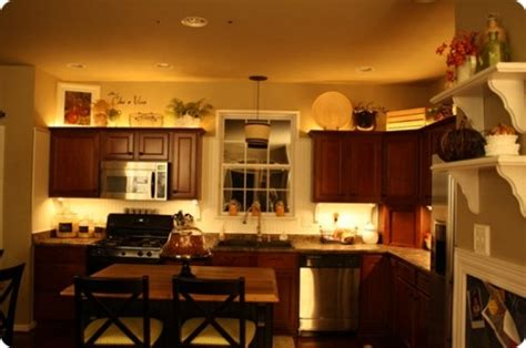 above cabinet lighting ideas for that awkward space above your kitchen cabinets