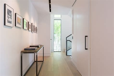 modern hallway  recessed trim  track lighting