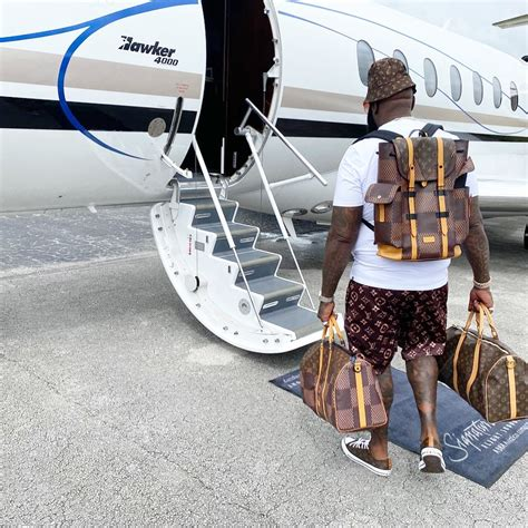 rick ross boards  private jet  full louis vuitton