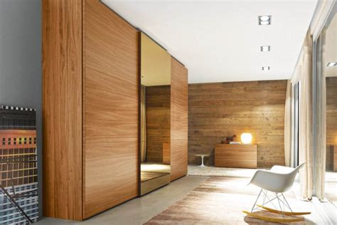 Wood Closet Doors For Bedrooms by Luxury Bedroom With Brown Wood Sliding Closet Doors And