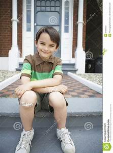 Happy Boy Sitting On Front Steps Of House Stock ...  Sitting