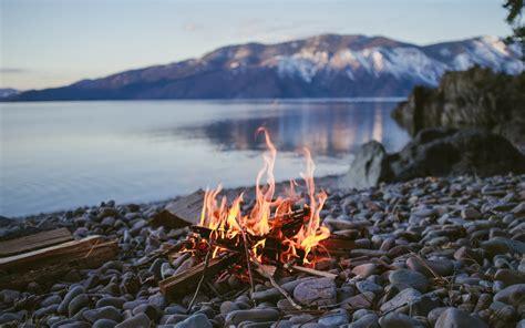 fire campfire lake stones stone depth  field nature water wallpapers hd desktop