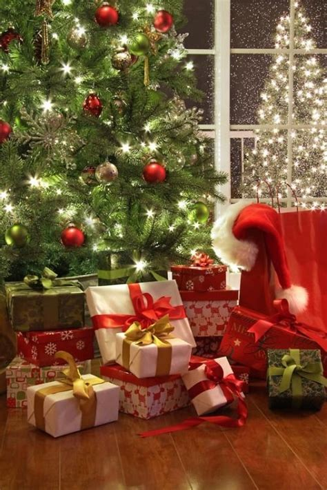 christmas gifts under the tree pictures photos and