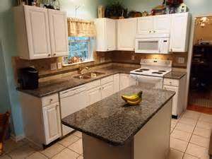 backsplash patterns for the kitchen caledonia granite for white cabinets traditional