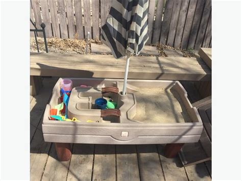 step  sand  water table  cover  umbrella west