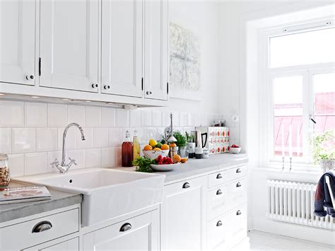 white kitchen with white subway tile kitchen subway tiles are back in style 50 inspiring designs 2107