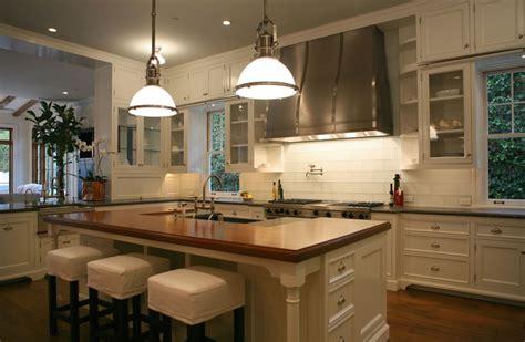 glass top kitchen island slipcovered bar stools transitional kitchen